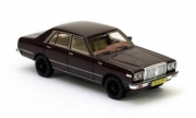 Datsun . 200L C230 metallic brown 1/43