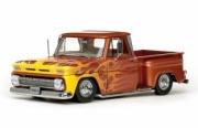 Chevrolet . Pickup Stepside low rider metallic orange with flame 1/18
